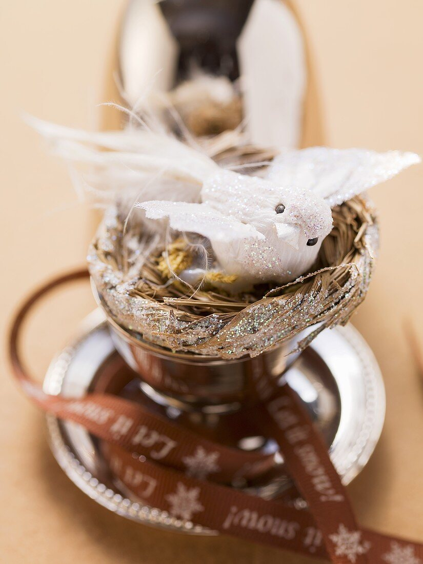 Christmas decoration of a white bird in a nest
