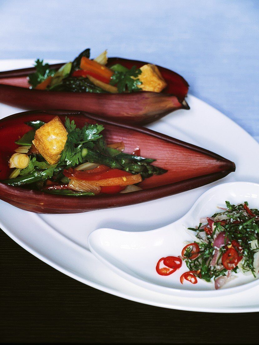 Pickled vegetables with tofu in a banana flower petal (Asia)