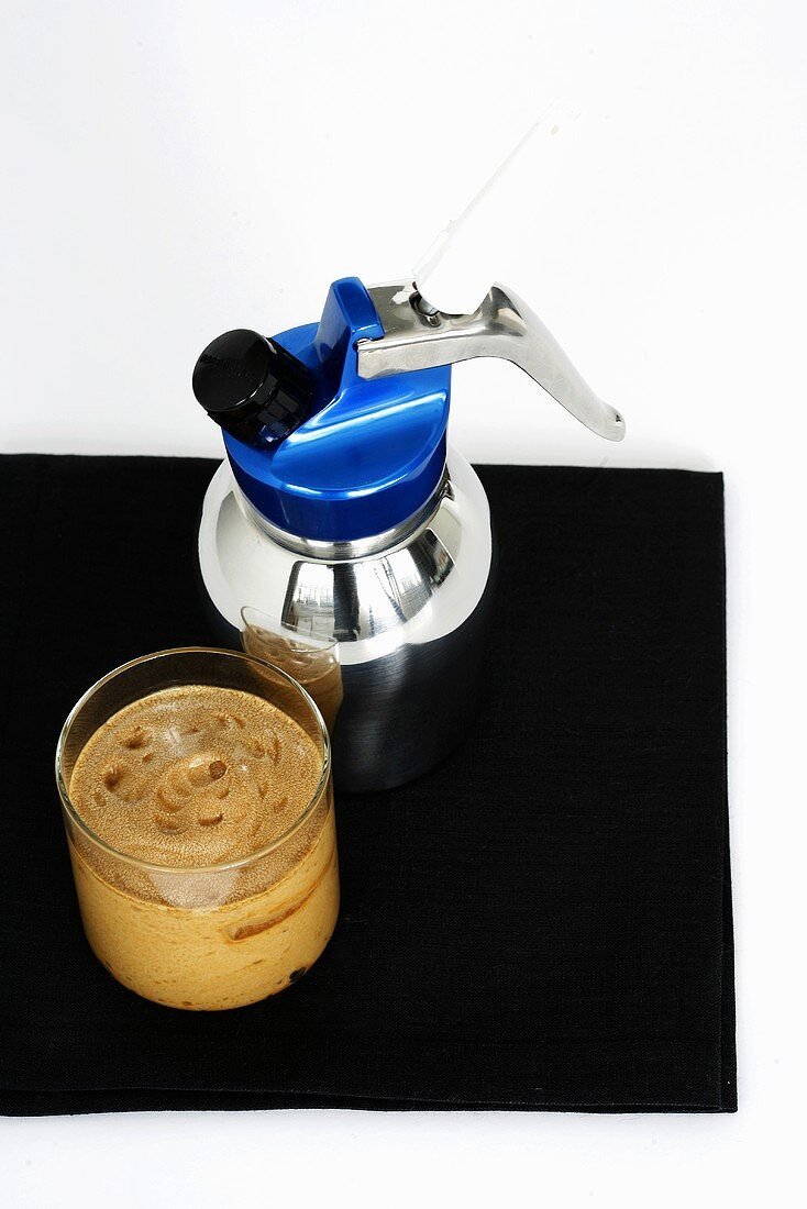 Frothy coffee cream with a soda syphon