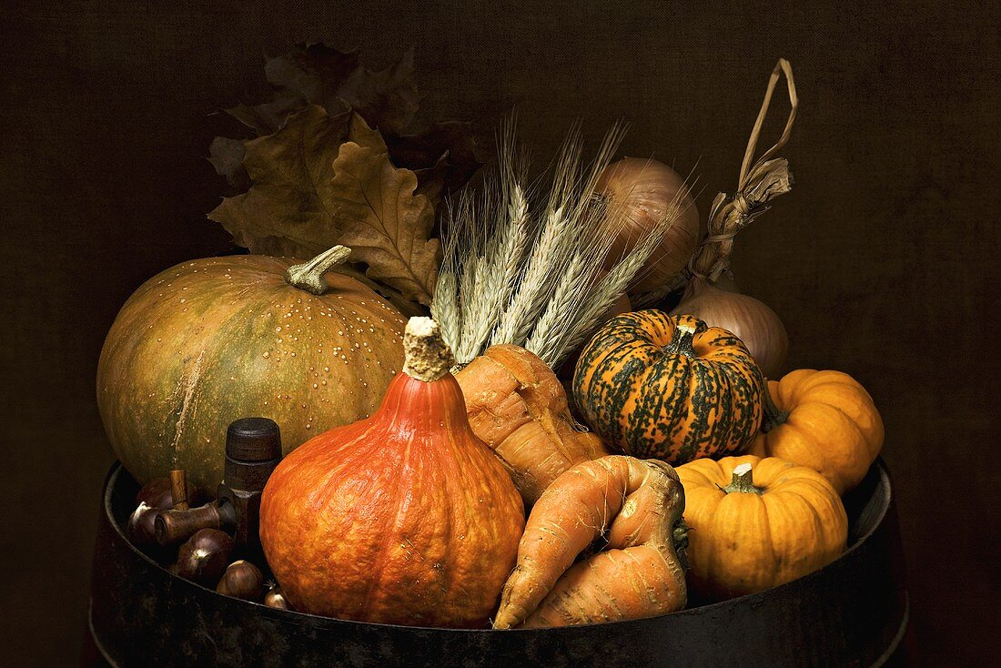 Autumn still life with pumpkins, carrots and chestnuts