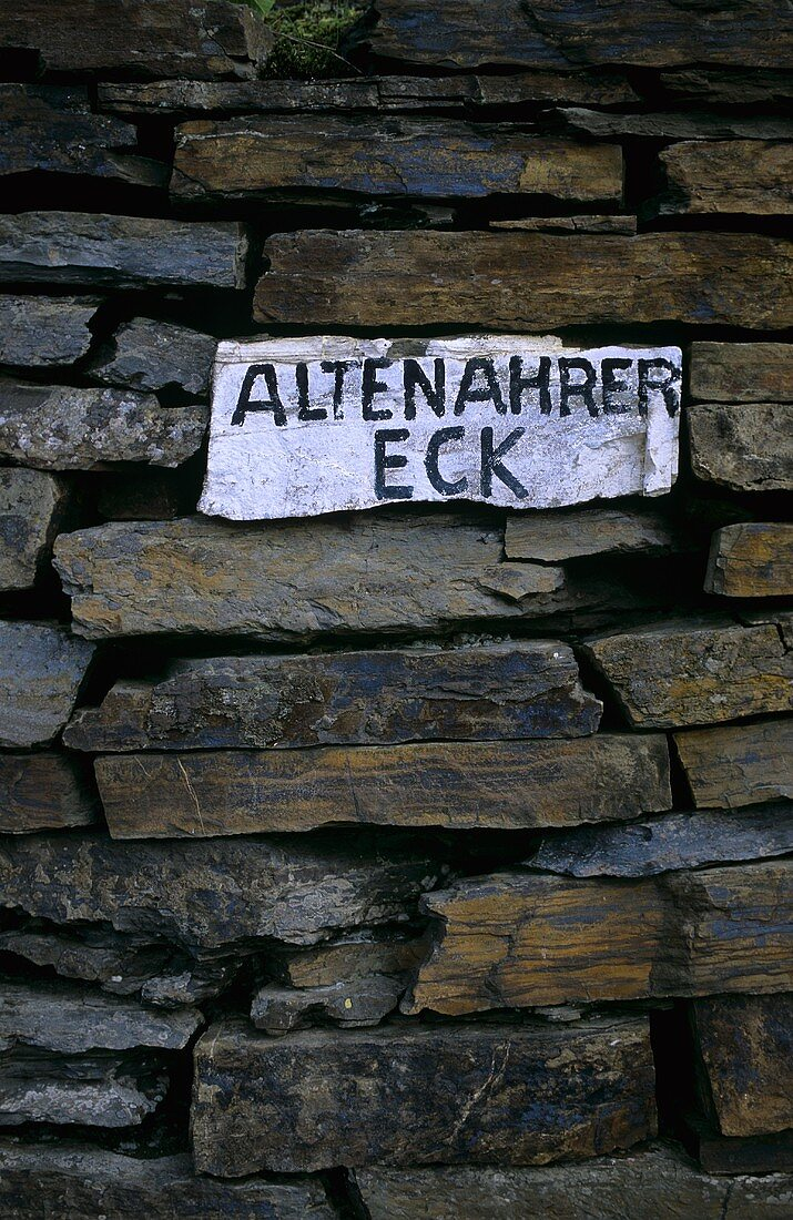 Slate wall with 'Altenahrer Eck' sign, Ahr, Germany