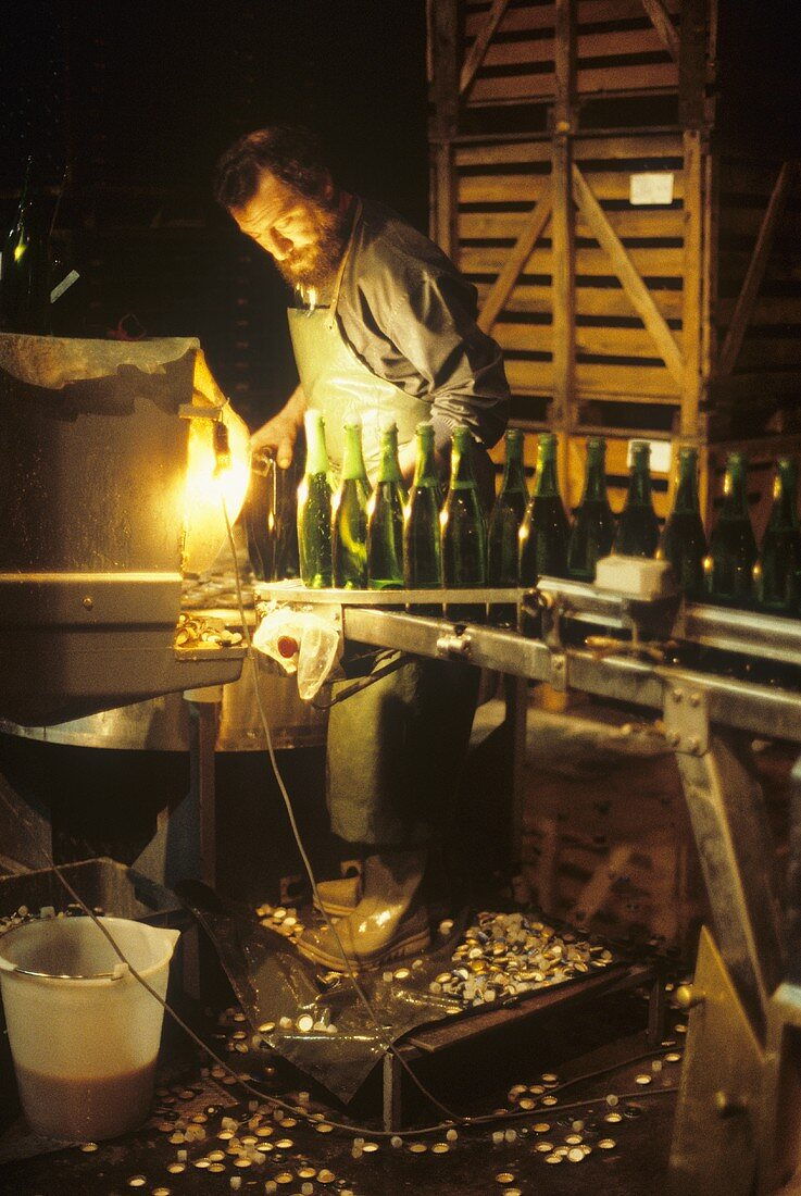 Degorgement: removing the sediment from sparkling wine