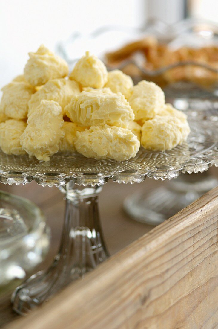 White chocolate confectionary on a glass stand