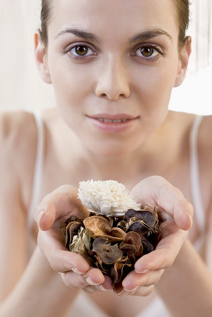 A woman holding pot pourri in her hands