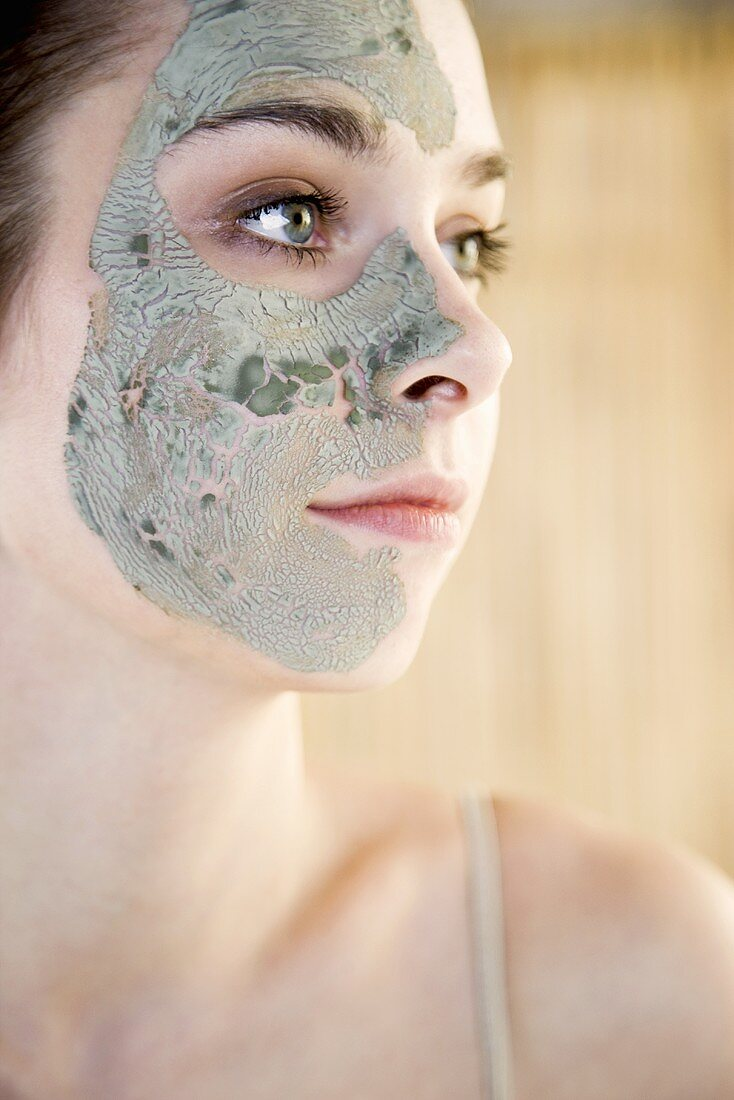 A woman with an aloe vera face mask