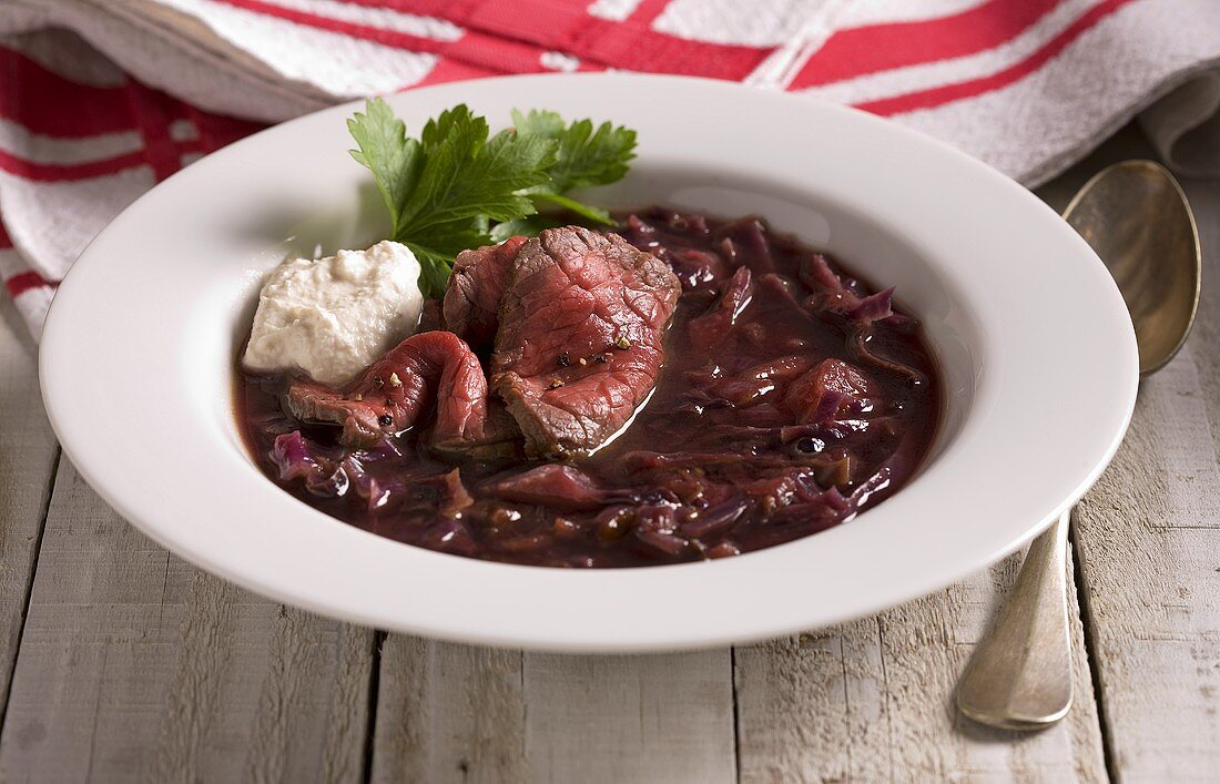Red cabbage soup with beef and horseradish sauce