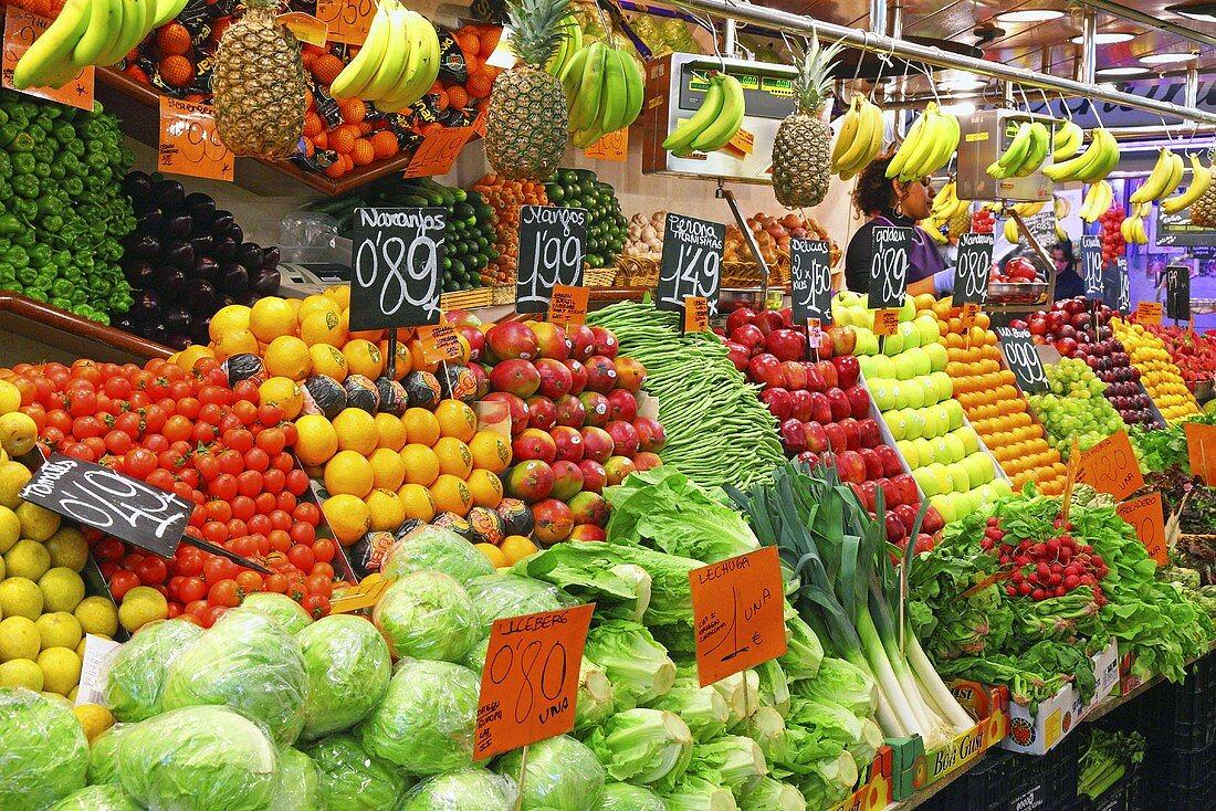 A fruit and vegetable market stall (Mercat de St. Josep (Boqueria), Las Ramblas, Barcelona, Spain)