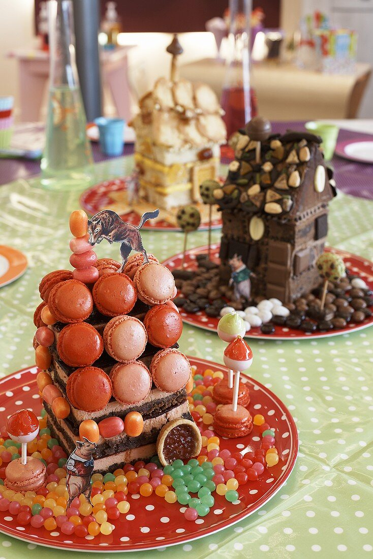 Small house made from strawberry cheesecake and macarons