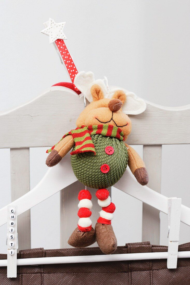 Coat hanger with Christmas decoration on chair