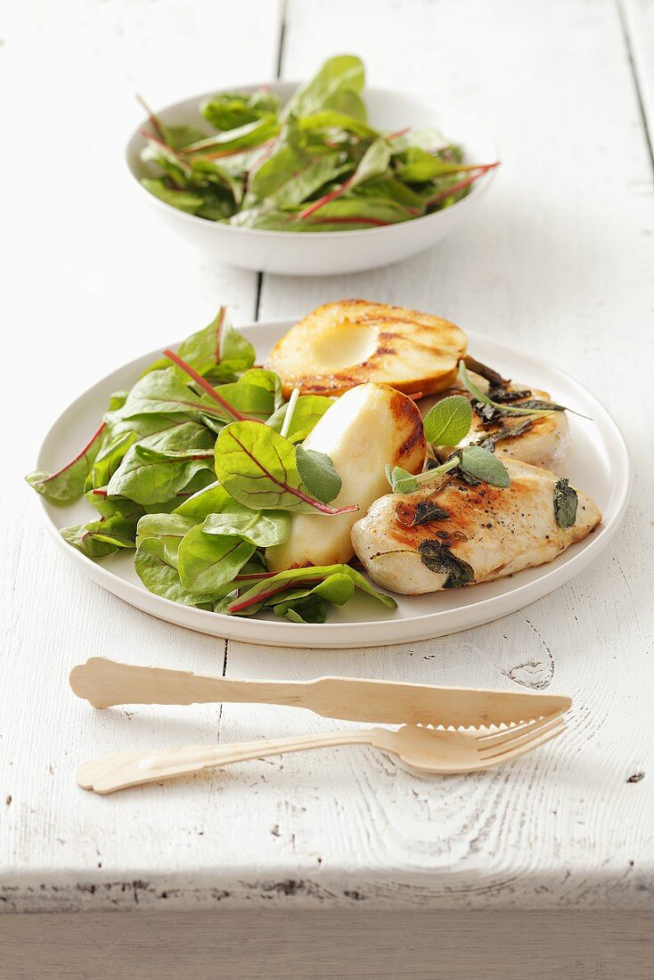 Barbecued chicken breast fillet with pear and baby leaf salad