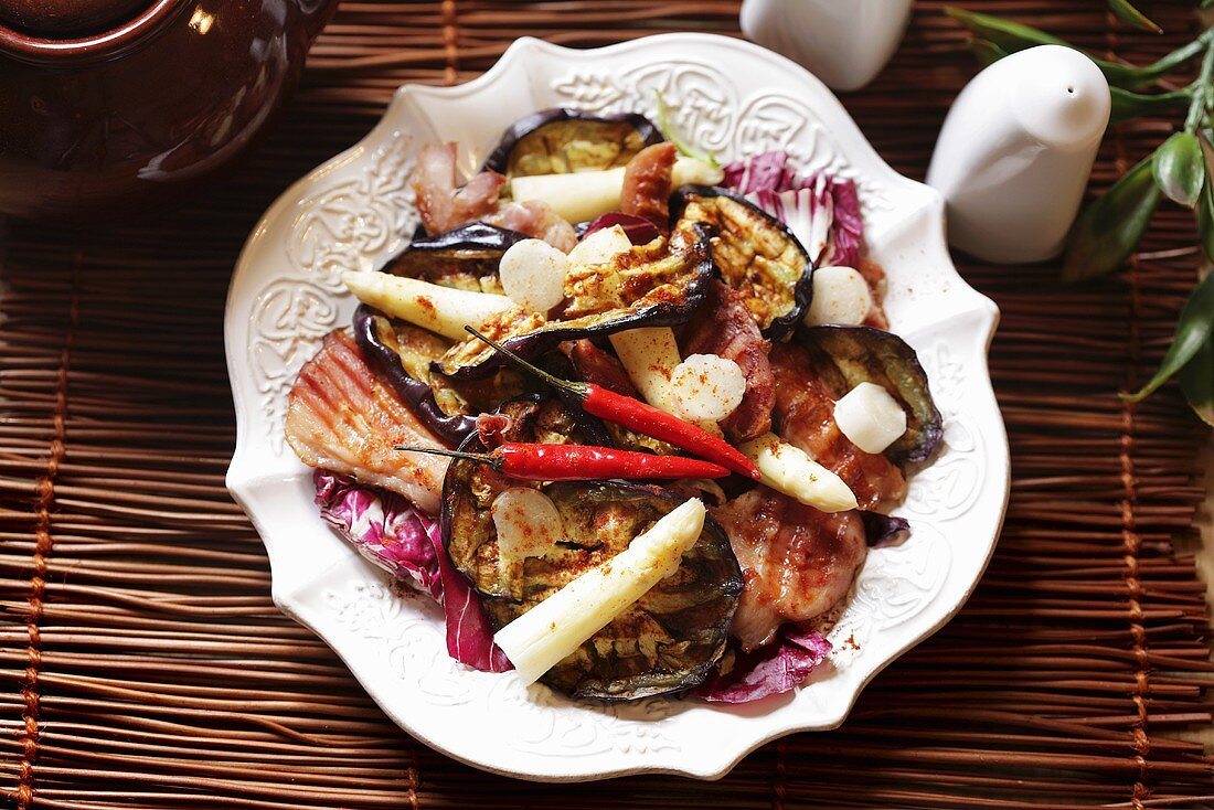 Salad leaves with chicken, grilled aubergine and asparagus
