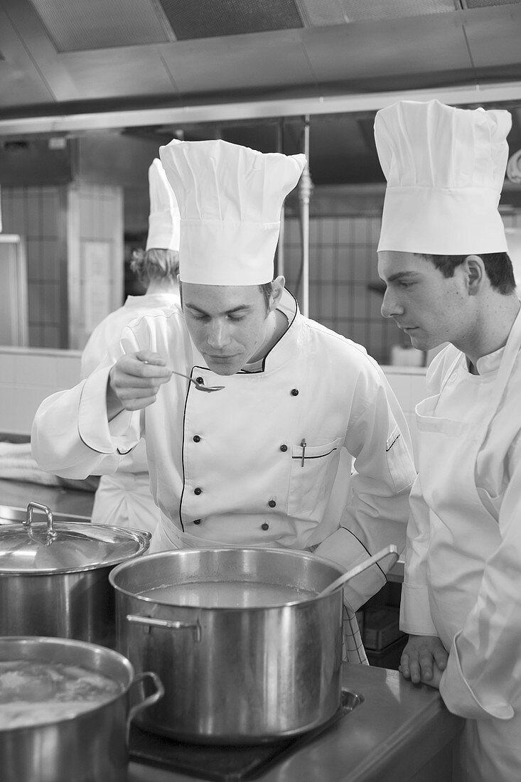 Chef tasting vegetable stock