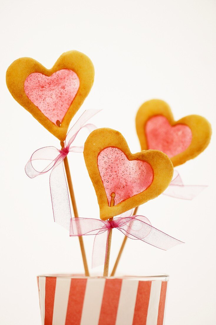 Three window cookies (biscuits with sugar 'window') on sticks