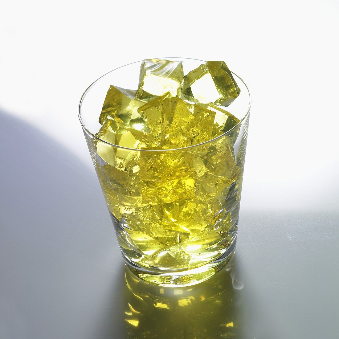 Yellow jelly cubes in a glass