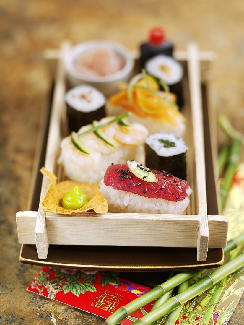 Assorted sushi on a wooden tray