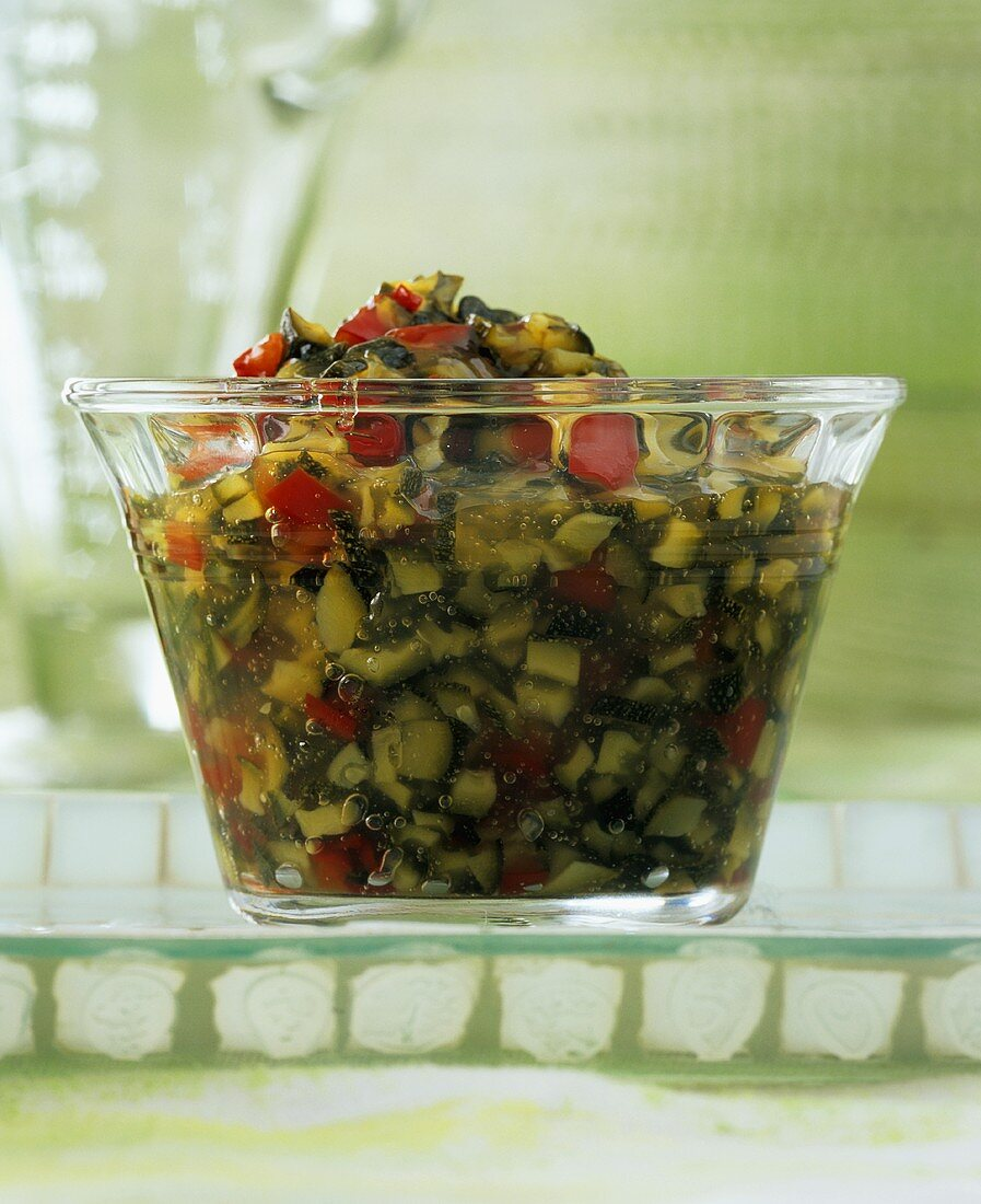 Courgette and pepper jam in a small bowl