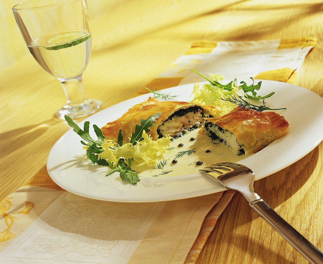 Puff pastry filled with fish and parsley