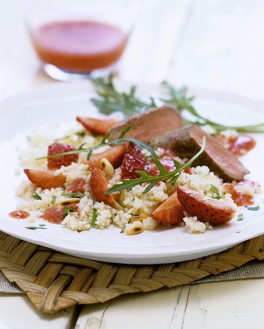 Strawberry couscous with venison fillet