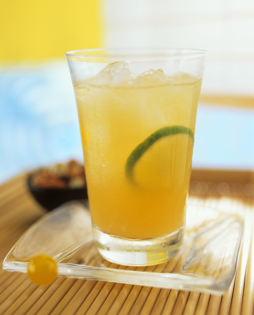 Fruit juice drink with ice cubes and lime