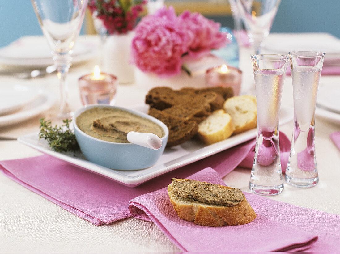 Liver pâté on baguette slice on table laid for special occasion