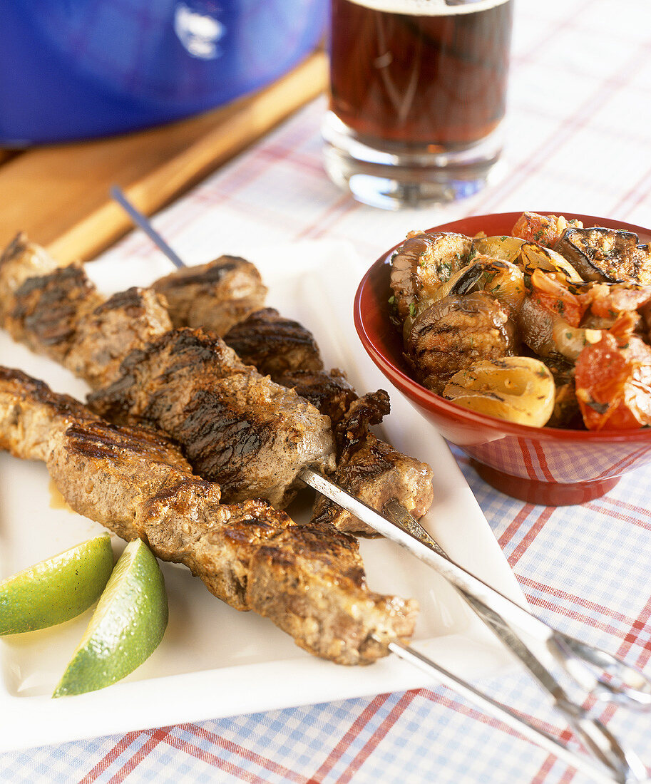 Grilled lamb kebabs and a dish of grilled vegetables