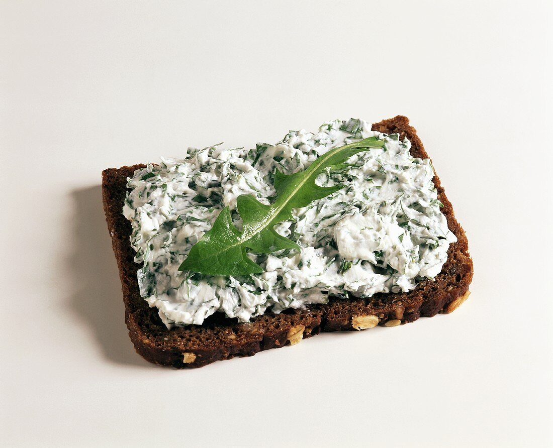 Quark with dandelion on bread