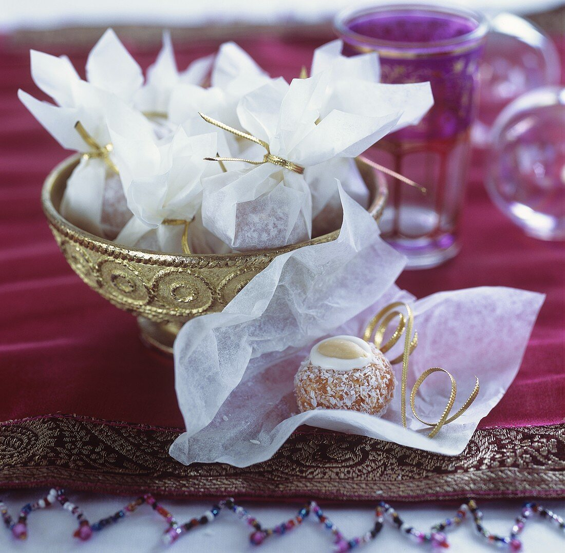 Coconut and almond balls wrapped in paper