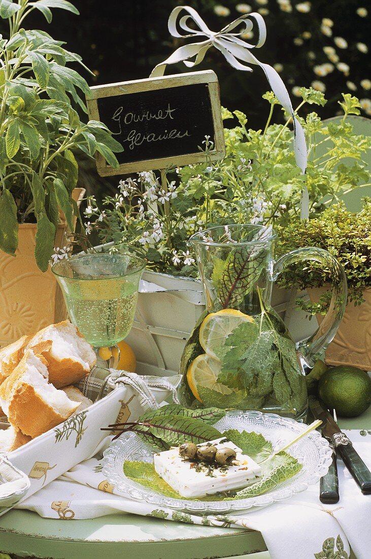 Feta with olives, ground elder punch, gourmet geraniums behind