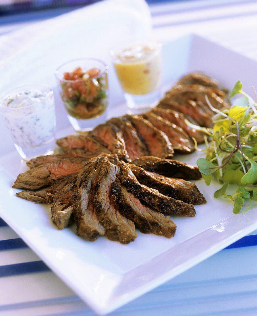 Roast loin of veal (medium rare) with three aromatic sauces