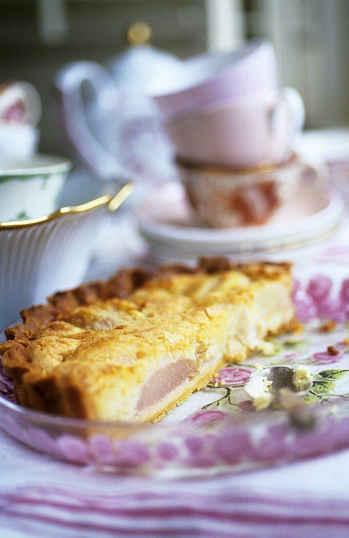 Pear tart, tea things in background