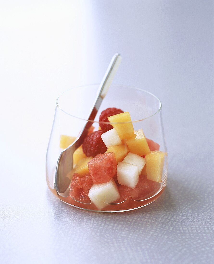 Chilled vodka with melon and raspberry salad
