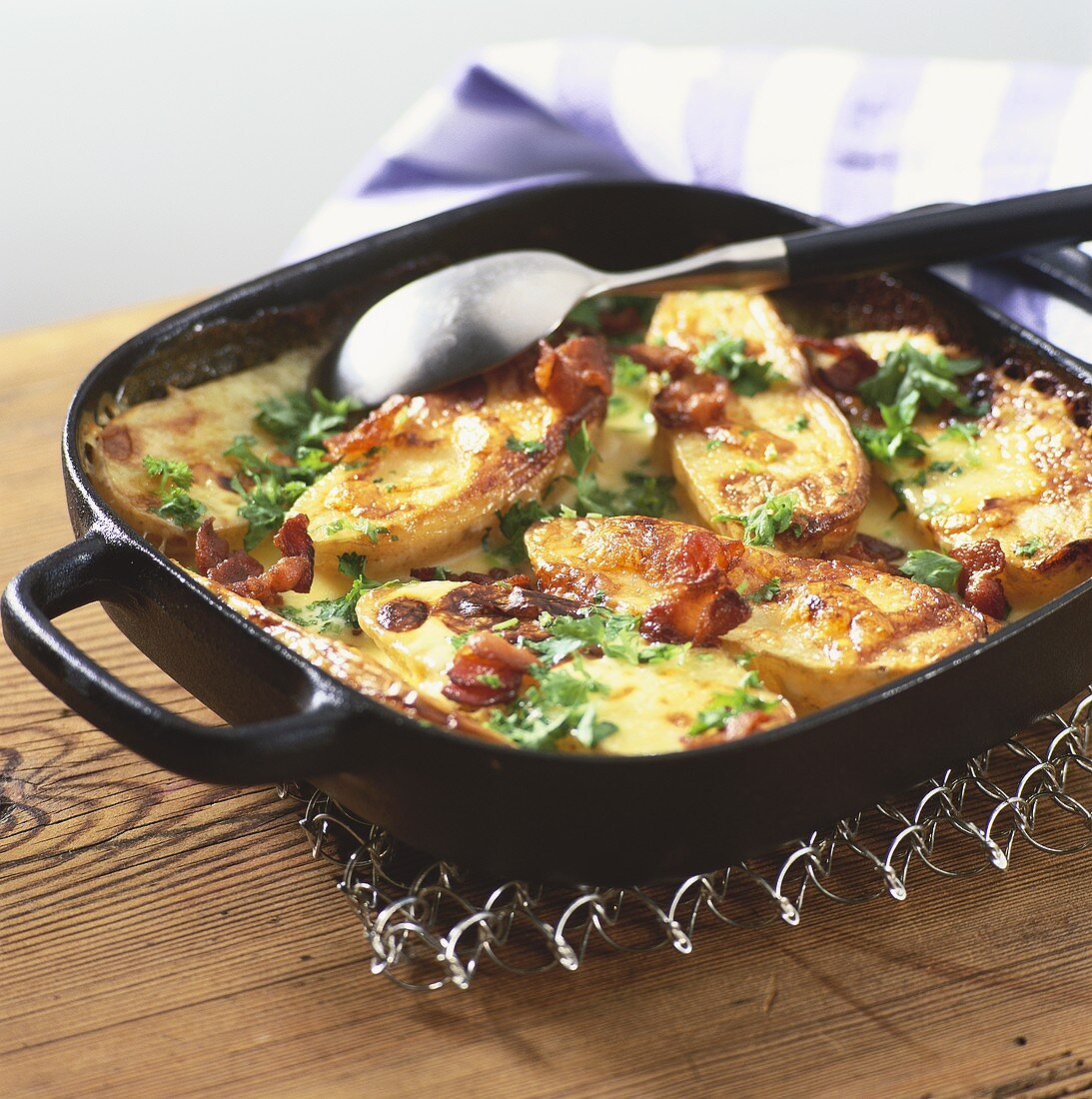 Oven-baked potatoes with bacon and cheese