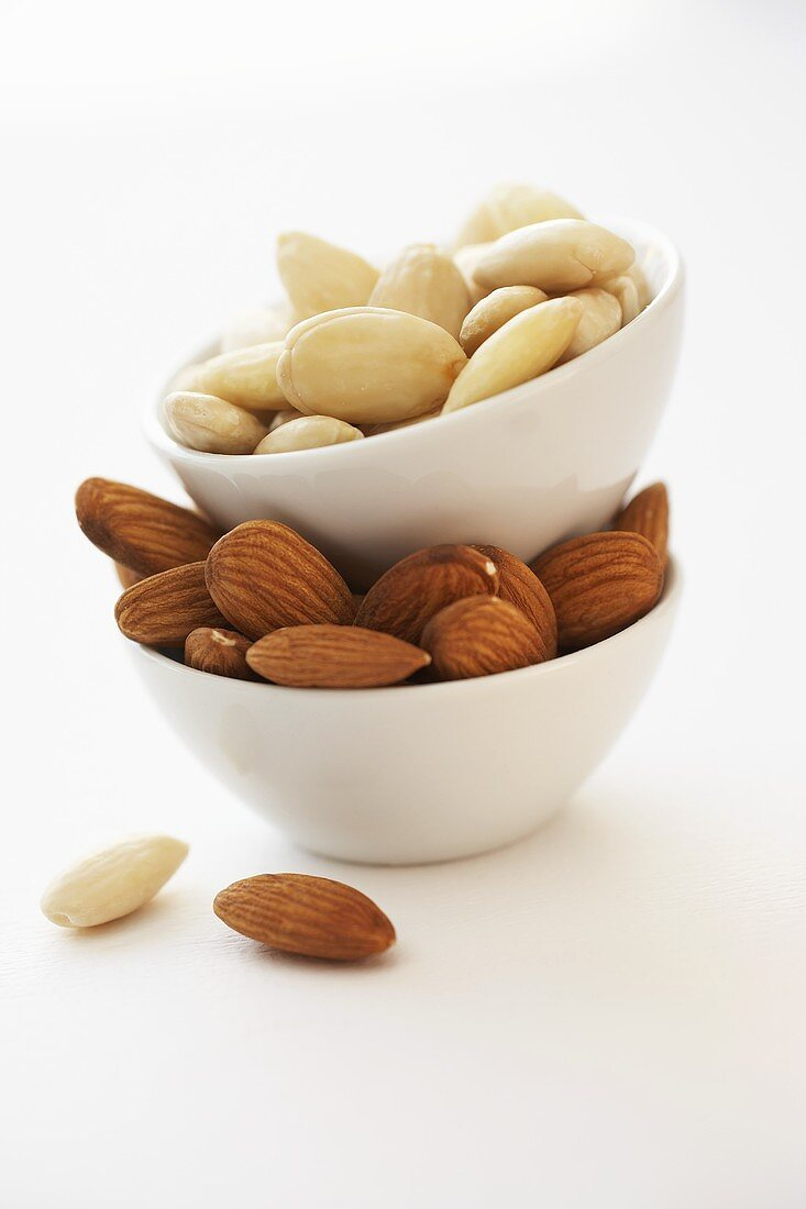 Shelled almonds in piled-up bowls