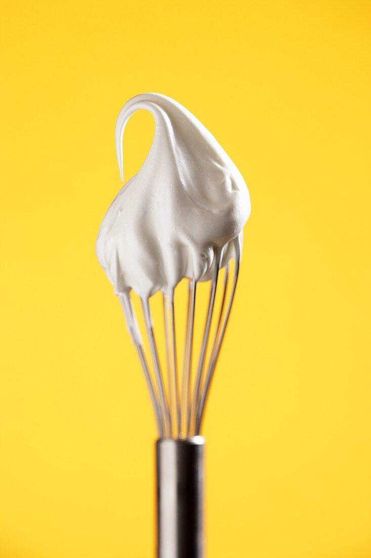 Beaten egg white on whisk
