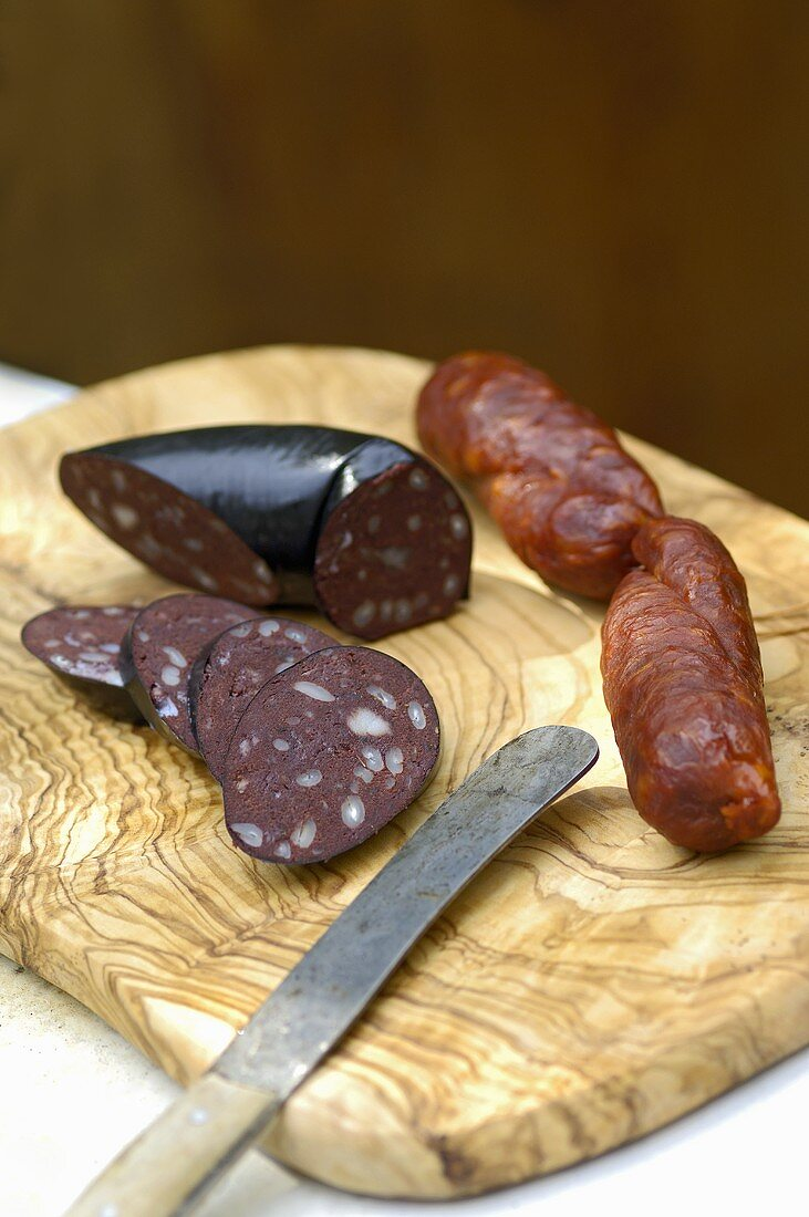 Black pudding and chorizo on a wooden board