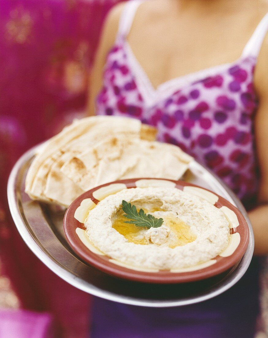 Hummus in dish with flatbread
