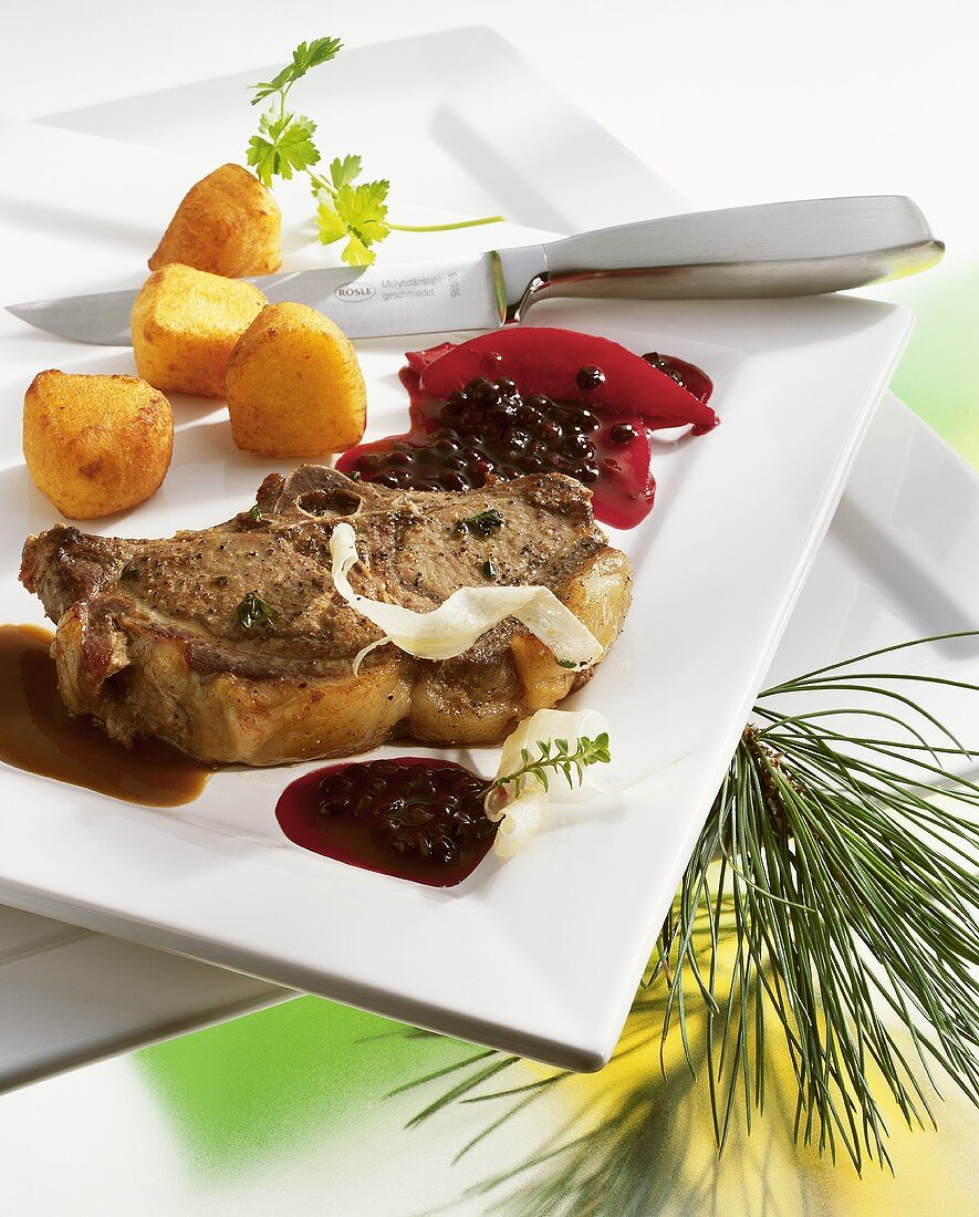 Wild boar chop with elderberry and quince sauce
