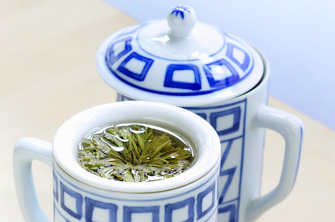 Lidded cup with tea bloom