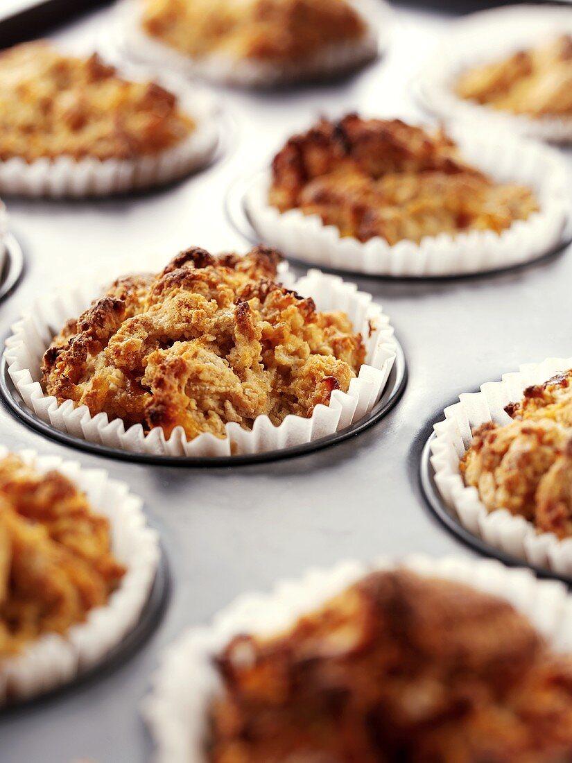 Mango muffins in the muffin tin