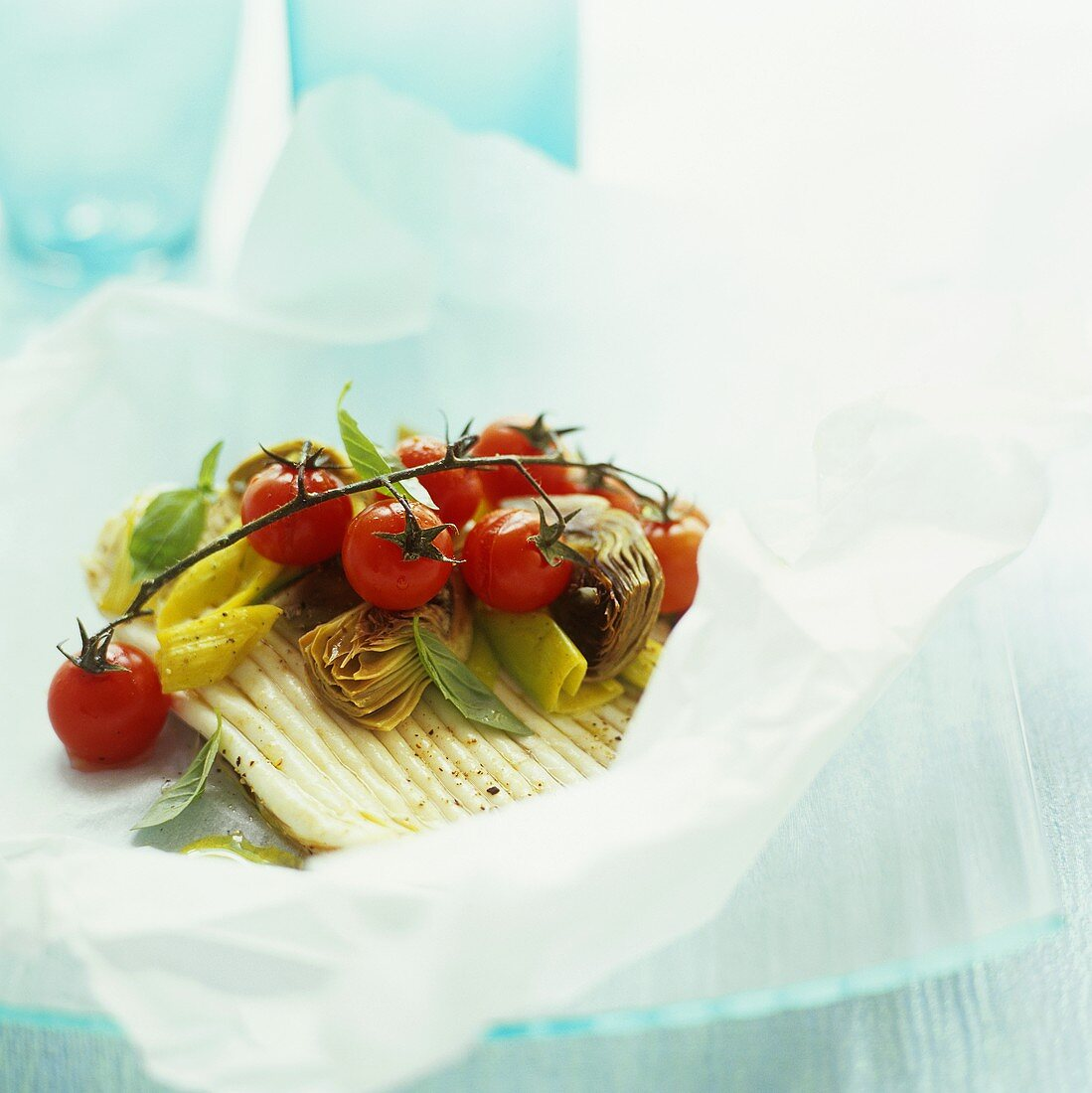 Skate wing with vegetables in parchment paper