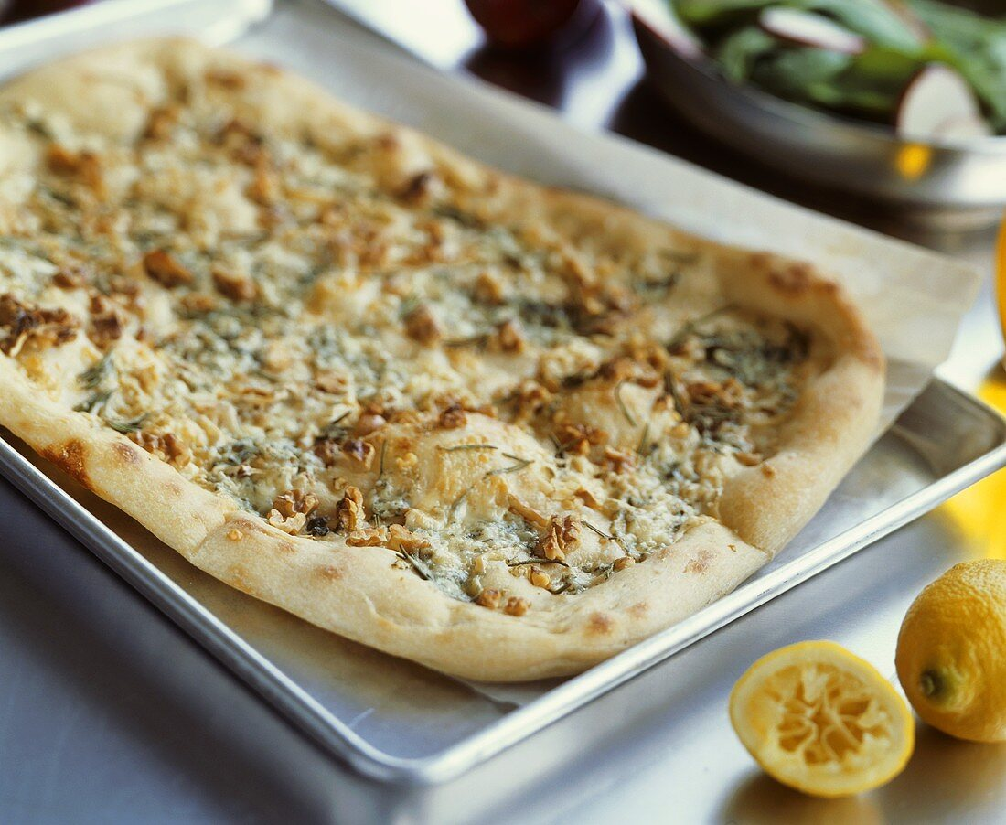Rustic pear pizza with blue cheese and nuts