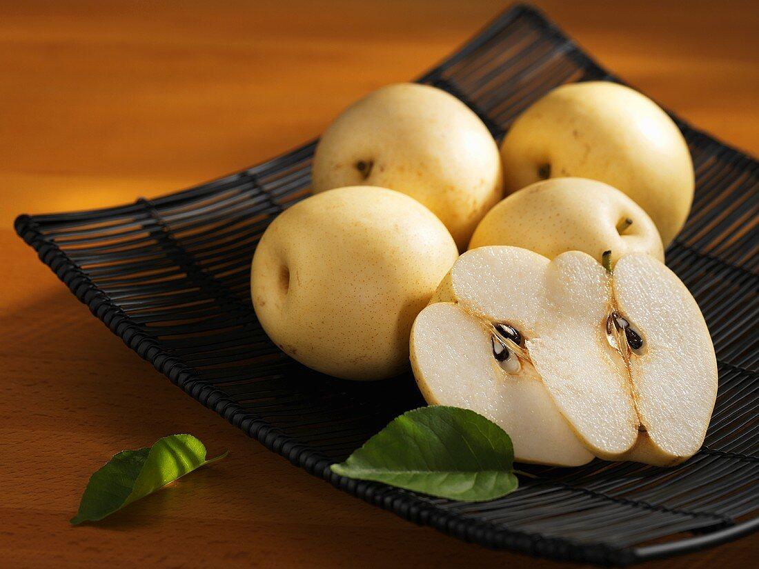 Nashi pears in a metal dish