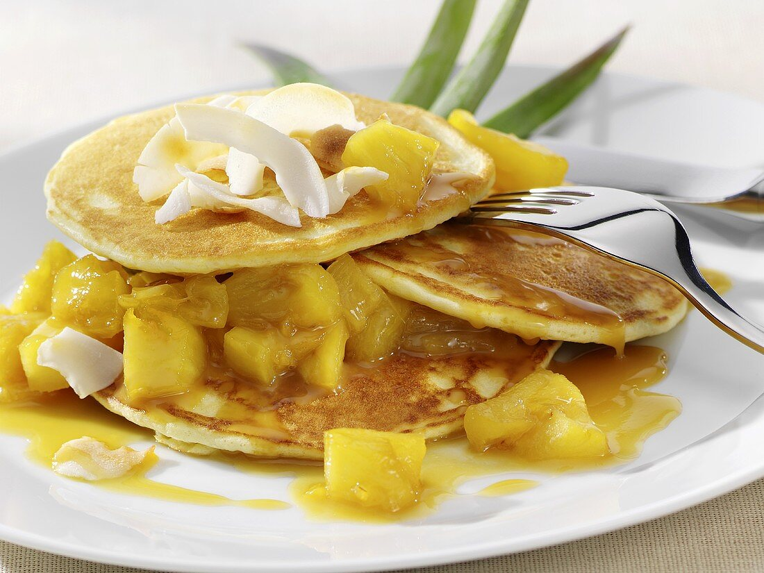 Pancakes with coconut and pineapple compote