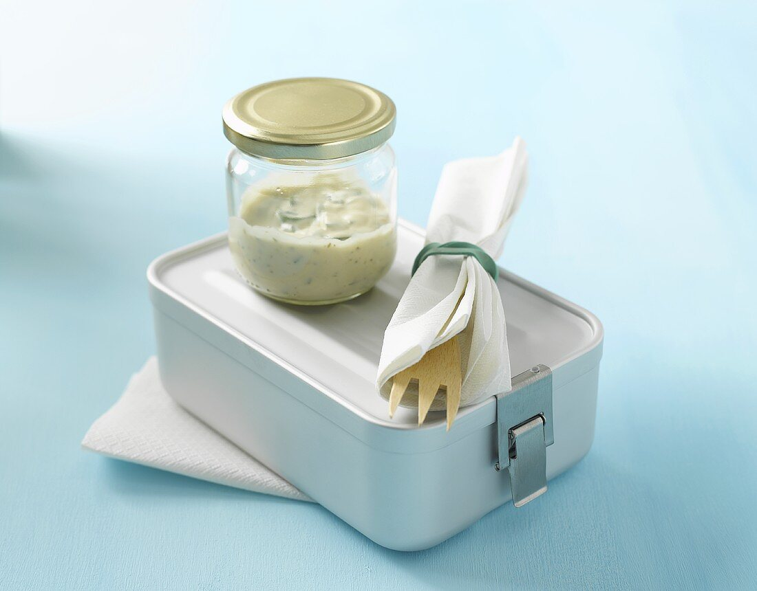 Lunch box, cutlery and dressing in screw-top jar