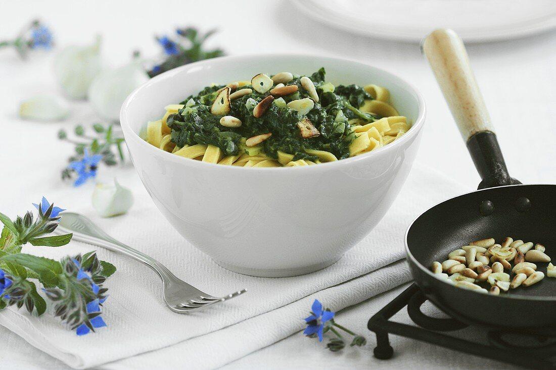 Ribbon pasta with borage, pine nuts and garlic