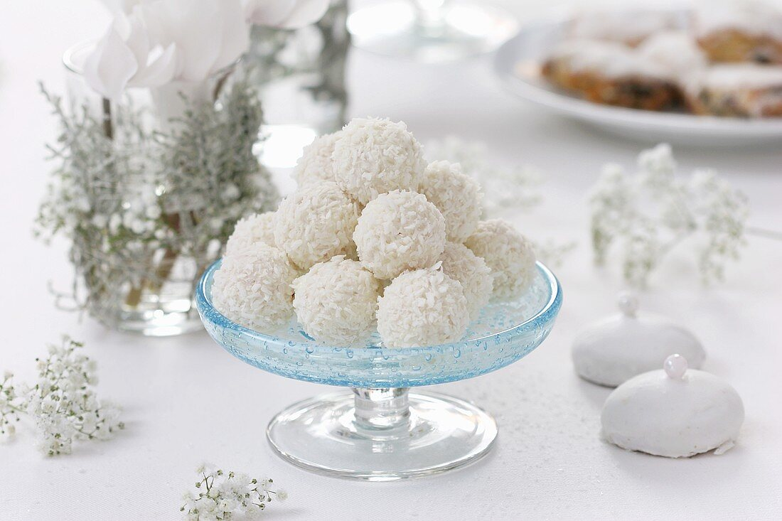 Coconut truffles on a glass pedestal stand