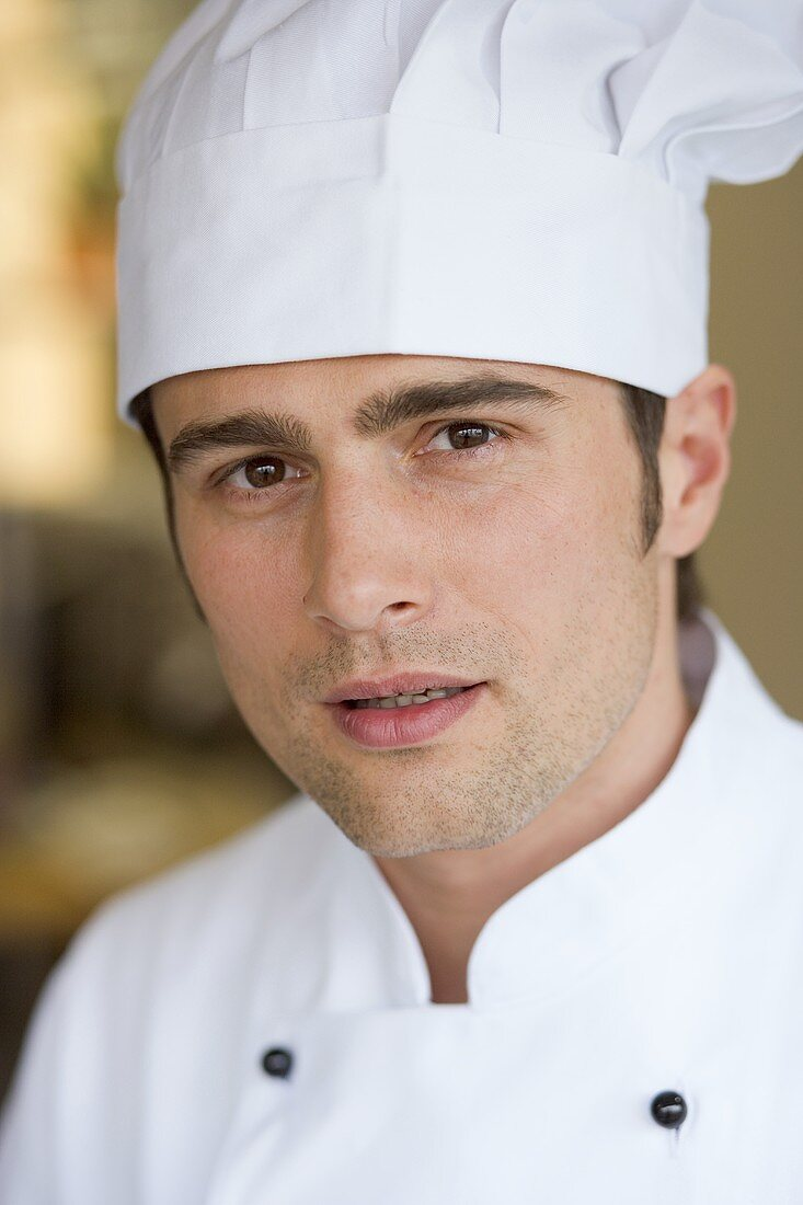 Young chef in chef's jacket and hat