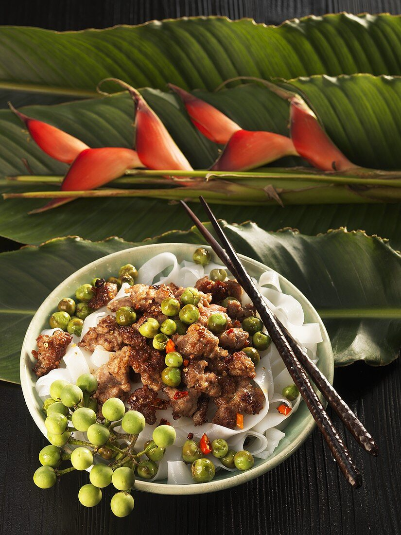 Fried mince with baby aubergines on rice noodles