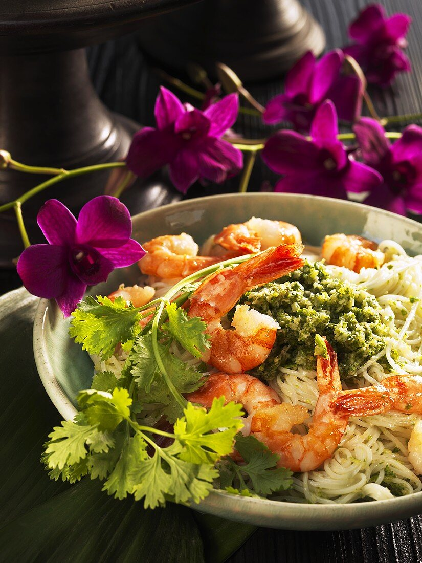 Rice noodles with king prawns and coriander pesto