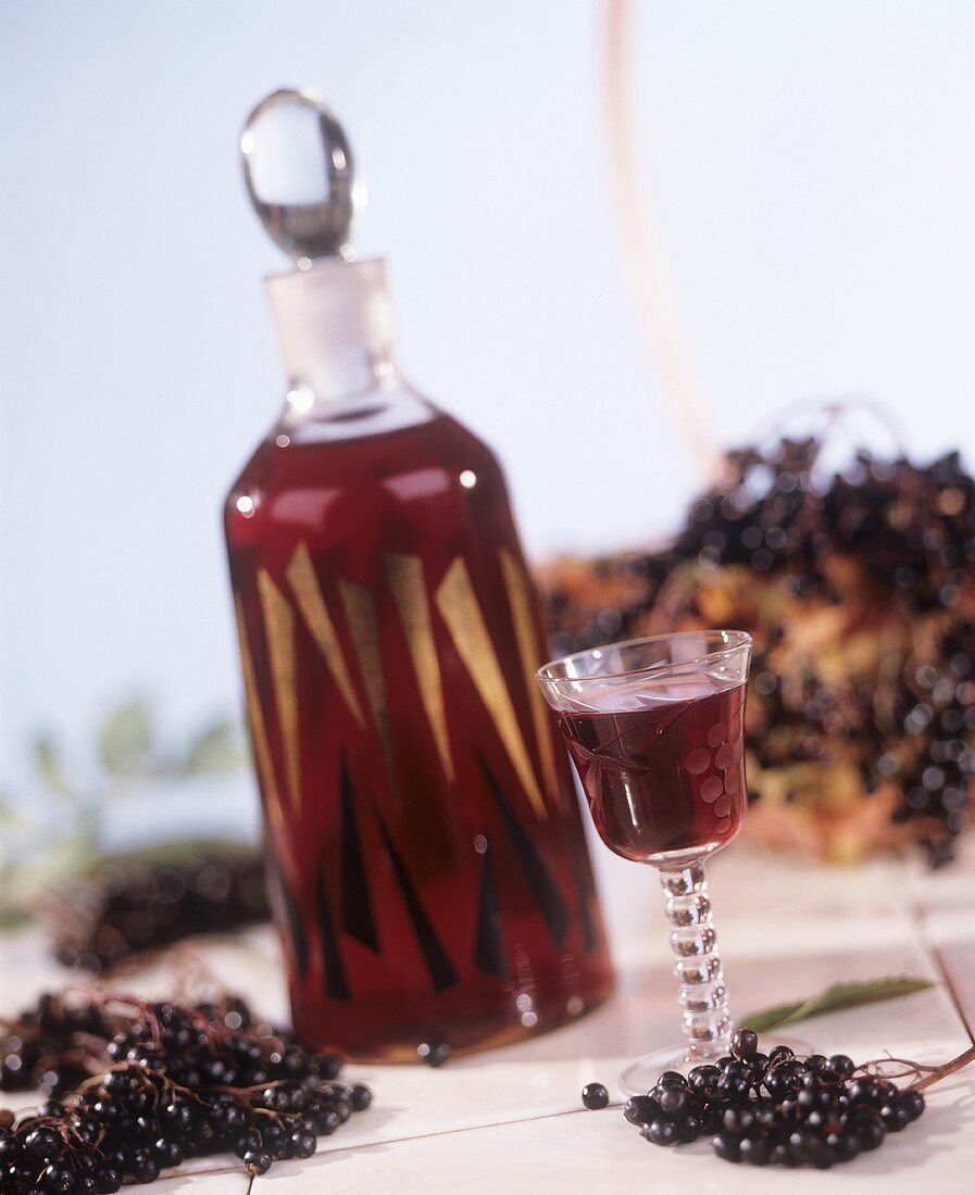 Elderberry liqueur in bottle and glass